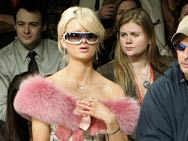 Natalie Reid, a Paris Hilton look-a-like, and former rocker and radio personality David Lee Roth, watch the Nicole Miller Fall 2006 fashion show in New York, Friday, Feb 3, 2006